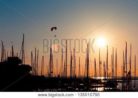 Sunset Paragliding Over Yachts
