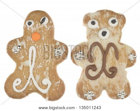 funny tasty gingerbread man and a teddy bear pattern and decorated with silver sugar balls isolated on white background