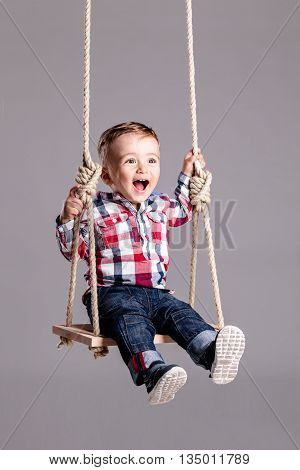 Baby Boy On A Swing