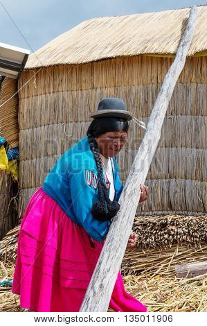 Woman On Floating Uros Islands On Lake Titicaca In Peru