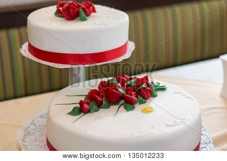 Wedding cake with the second floor decorated with roses