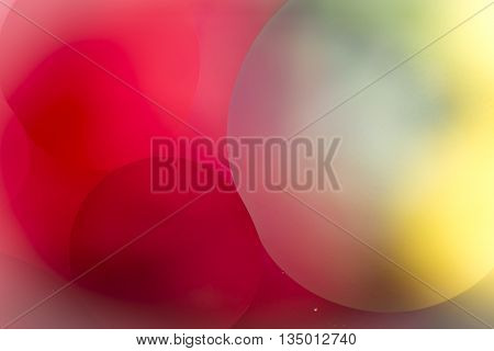 Multi coloured background with circles of various diameters