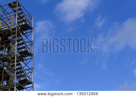 Construction scaffolding element. Blue sky background. Construction or reconstruction concept