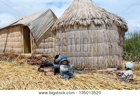 Children On Floating Uros Islands On Lake Titicaca In Peru