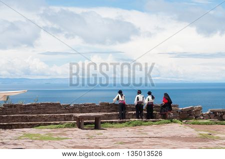 TAQUILE PERU - MARCH 20 2015:Men in traditional clothes at Taquile Island at lake Titicaca in Peru