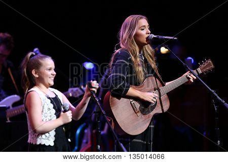 NEW YORK-APR 30: Maisy Stella (L) and Lennon Stella perform onstage during the 'Nashville' Tour at The Beacon Theatre on April 30, 2015 in New York City.