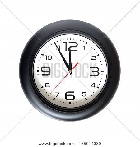 Big round wall clock, with a black rim isolated on white background close-up and arrows showing almost twelve o'clock