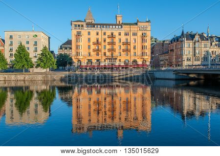 NORRKOPING, SWEDEN - JULY 14, 2010: Downtown Norrkoping and Motala river on a sunny summer evening. Norrkoping is a historic industrial town.