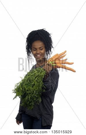 Teenage girl with a carrot on white background