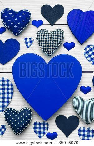 Blue Heart Texture With Copy Space For Advertisement Or Free Text. White Wooden Background. Textile Hearts Which Are Dotted and Striped. Greeting Card For Valentines Day. Vertical And Macro View