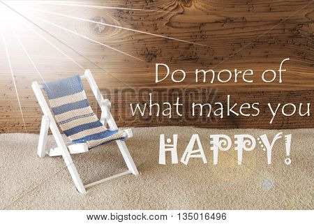 Sunny Summer Greeting Card With Sand And Aged Wooden Background. English Quote Do More Of What Makes You Happy. Deck Chair For Holiday Or Vacation Feeling.