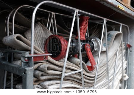 Blank, flat rolled fire hoses on a fire truck