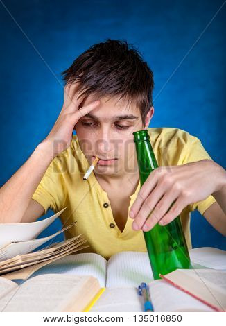 Tired Student with the Beer and Cigarette on the Blue Background