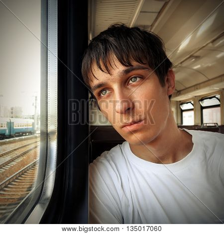 Toned Photo of Sad Teenager in the Train