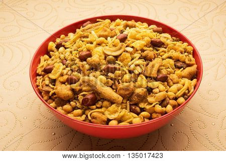 Traditional indian deep fried salty dish - chivda or mixture or farsan or farsaan made of gram flour and mixed with dry fruits