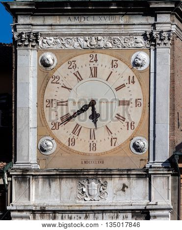 The clock on the Torre dell'Orologio the Clock Tower of the Modena Town Hall a part of the Modena's UNESCO World Heritage Site