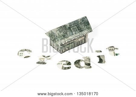 House built of dollar bills with the words credit, carved out of the money isolated on white background