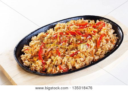 rice with vegetables chicken in a pan isolated white background cast iron wok