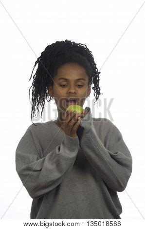 Teenage girl biting an apple on white background