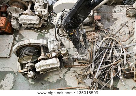Industrial landscape with unclear mechanisms devices and metal scrap.