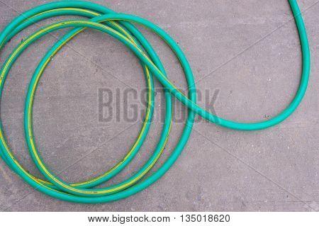 equipment garden hose water on concrete floor