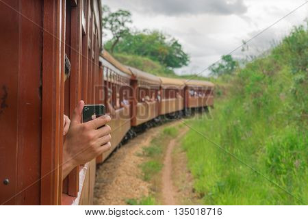 Tourist Taking Self Picture In Old May Smoke Train