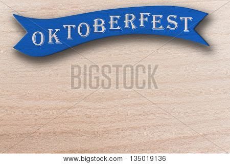 oktoberfest blue ribbon on maple wooden background