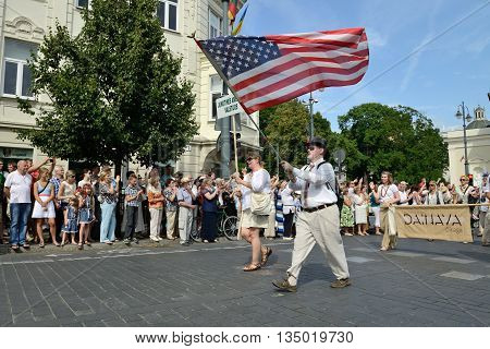 VILNIUS, LITHUANIA - JULY 6: Unidentified peoples parade (guests from United States) in traditional Lithuanian Song Celebration on July 6, 2014 in Vilnius, Lithuania