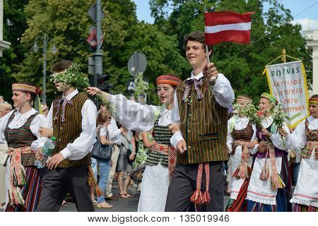 VILNIUS, LITHUANIA - JULY 6: Unidentified peoples parade (guests from Latvia) in traditional Lithuanian Song Celebration on July 6, 2014 in Vilnius, Lithuania