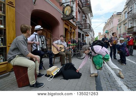 VILNIUS, LITHUANIA - MAY 17: Unidentified musician play guitar and other instrument in Street music day on May 17, 2014 in Vilnius. Its a most popular event on May in Vilnius, Lithuania