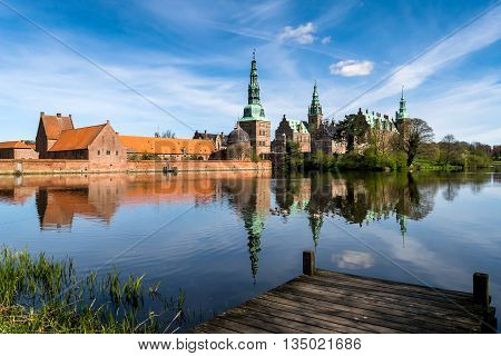 Morning sight of Frederiksborg Castle across the lake, settled in a town Hilerod, north-west of Copenhagen, Denmarklandmark in Copenhagen
