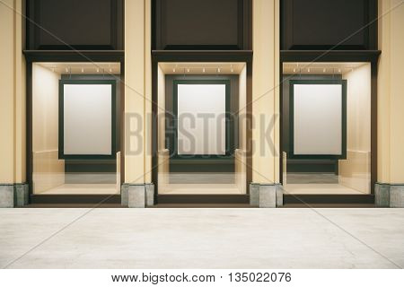 Shop exterior with blank frames in showcase. Mock up 3D Rendering