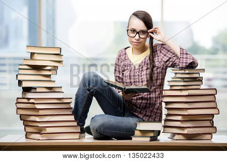 Young student with stack of books