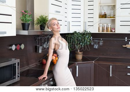portrait of the blonde with in modern kitchen