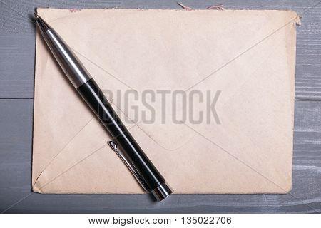 Old vintage elegant business pen letter sheet paper grey wooden background flatlay