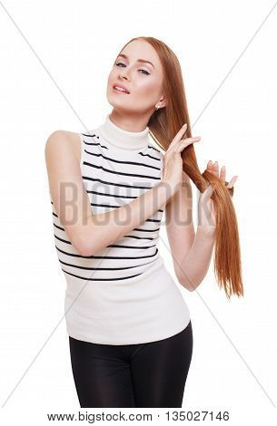 Redhead woman with strong healthy hair portrait. Young red ginger girl shows natural hair strength.