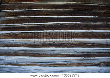 Wooden log cabin siding with bleached wood