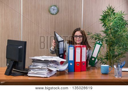 Businesswoman under stress working in the office