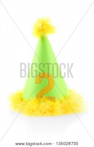 Funny birthday cap with yellow fur isolated on white