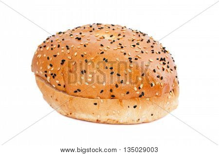 Burger bun with sesame seeds isolated on white background with clipping path