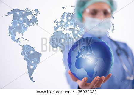 Woman doctor holding earth in globalisation concept