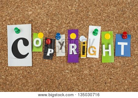 Copyright word as letters pinned on cork board