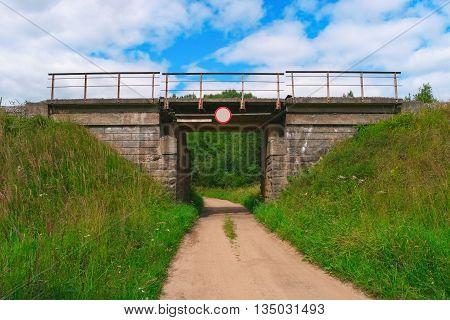 Railway bridge over a rural gravel road