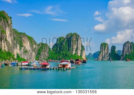 Floating fishing village in Halong Bay, Vietnam, Southeast Asia. UNESCO World Heritage Site.