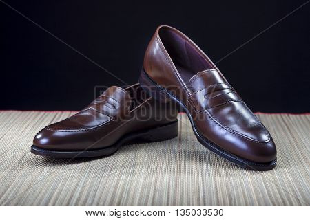 Footwear Concepts and Ideas. Pair of Stylish Expensive Modern Calf Leather Brown Penny Loafers Shoes.Closeup Shot. Horizontal Image