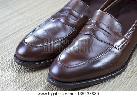Pair of Stylish and Fashinable Brown Penny Loafer Shoes.Horizontal Image Orientation