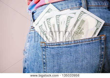 Bribery and corruption concept with dollar banknote in jeans back pocket