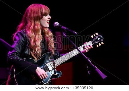 NEW YORK-APR 30: Aubrey Peeples performs onstage during the 'Nashville' Tour at The Beacon Theater on April 30, 2015 in New York City.