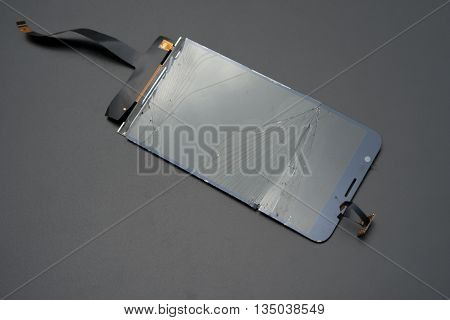 broken screen of a smart phone on a black background 2