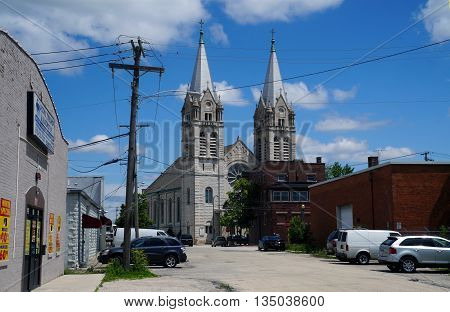 JOLIET, ILLINOIS / UNITED STATES - JUNE 1, 2015: The twin spires of the historic Saint Joseph's Roman Catholic Church are among the most prominent and impressive features of downtown Joliet.